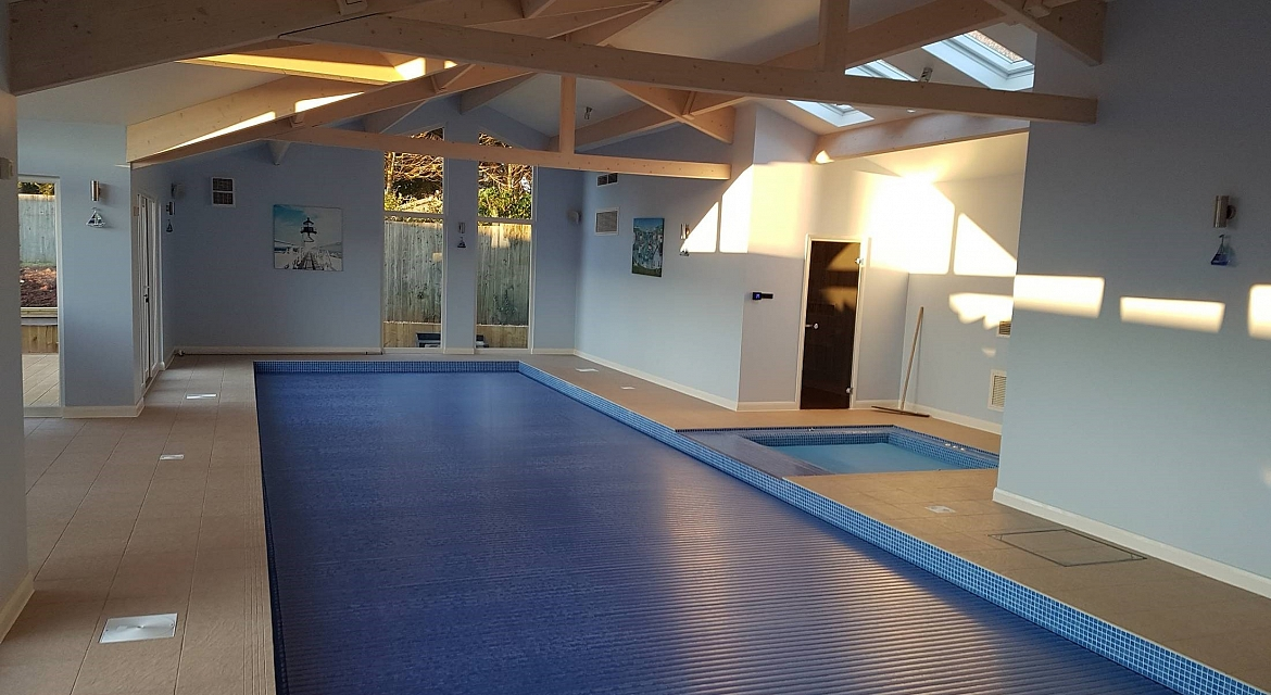 A bespoke residential indoor pool with spa sauna and for Building an indoor pool at home